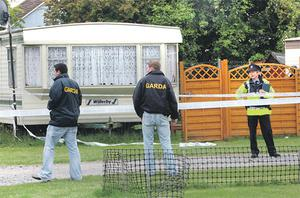 Gardai at the scene of the shooting at Vivian Hand Caravan Park in Donabate, north Dublin yesterday