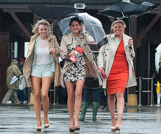 Sarah Judge from Sligo along with Ali Williams and Aibhe McDonnell from Cork battle the high winds and rain on day two of the Punchestown Festival