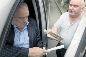 Thomas McFeely (left), developer of Priory Hall, is issued with court summons in October