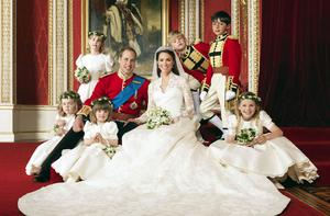 Britain' s Prince William and his bride Catherine, Duchess of Cambridge, pose for an official photograph, with their bridesmaids and pageboys, on the day of their wedding, in the throne room at Buckingham Palace.
