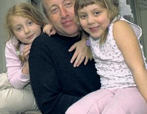 Broken home: Tim Lott, pictured with his daughters Ruby  and Cissy, understands the pain felt by other divorced dads such as the author Louis de Bernière