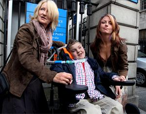 Cullen Kennedy (10) who suffered injuries in a car crash in 2008 that left him permanently confined to a wheelchairwas awared €11.5 million at the High Court today. He is pictured here with grandmother Monica Kennedy (left) and his mother Margaret (right). Photo: Courtpix