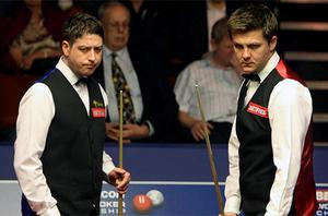 Ryan Day (right) at the table during his match with Matthew Stevens. Photo: PA
