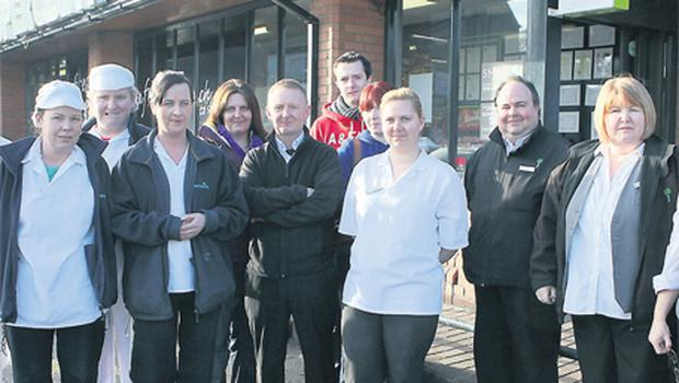 Some of the staff at the Naas Superquinn store yesterday, who were shocked at the news the store is to close
