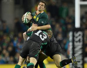10 November 2012; Ruan Pienaar, South Africa, is tackled by Keith Earls, left, and Mike McCarthy, Ireland. Autumn International, Ireland v South Africa, Aviva Stadium, Lansdowne Road, Dublin. Picture credit: Stephen McCarthy / SPORTSFILE