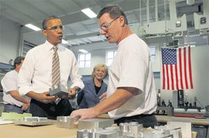 President Barack Obama listens as he tours WestStar Precision, a small manufacturing business that the president claims will benefit from the bipartisan proposals in the American Jobs Act, in Apex, North Carolina, yesterday