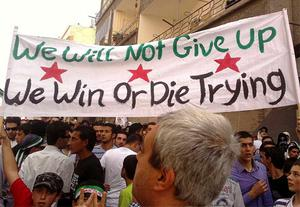 Demonstrators take part in a protest against Syria's President Bashar Al-Assad in Dael, near Deraa. Photo: Reuters