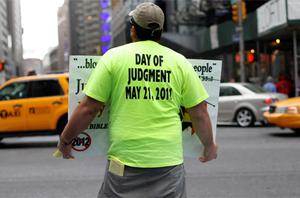 A volunteer from the US religious group Family Radio holds a sign with warnings of an impending Judgment Day. Photo: Reuters