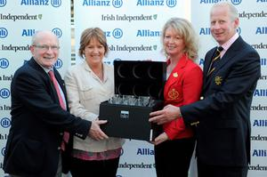 Moira Cassidy, director of golf at Portmarnock Hotel and Golf Links (2nd left) presents fourth prize to The K Club team of Jim Kirwan, vice captain, Sally Ann O Connor, lady captain and Tom Taaffe, captain.