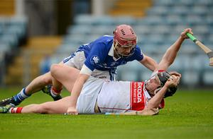 Jake Dillon of De La Salle tries to get away from Sarsfields Stephen Maher