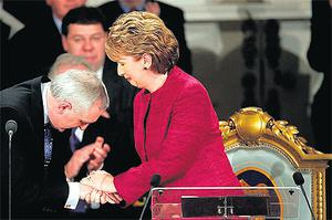 President Mary McAleese, with the current presidential chair in the background, being greeted by Bertie Ahern during the swearing-in ceremony for her second term in 2004