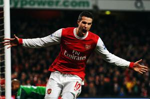 Robin van Persie celebrates after completing his hat-trick against Wigan. Photo: Getty Images