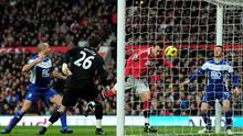 Ben Foster can only look on as Dimitar Berbatov heads home the first goal. Photo: Getty Images