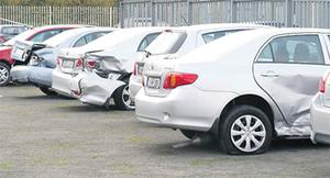 Damaged cars in Malone's Toyota dealership on the Kells Road.