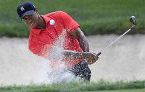 Tiger Woods hits out the the sand trap on the 10th hole during the final round of the Memorial golf tournament at the Muirfield Village Golf Club in Dublin, Ohio. Photo: Associated Press