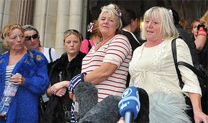 Dale Farm resident Kathleen McCarthy (right) addresses the media at the High Court. Photo: PA