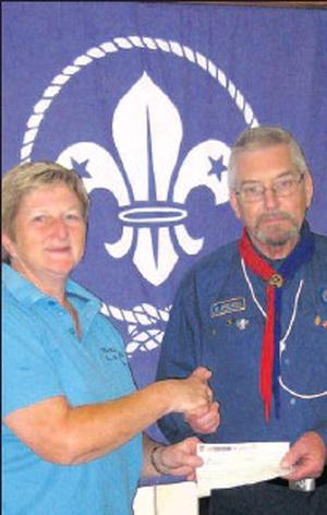 Michael Crawley making a presentation to Fiona Squibb LSPCA.