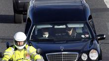 The hearse with the body of Michaela Harte leaves George Best Airport. Photo: PA
