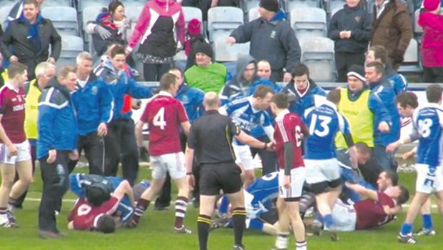Fans look on in terror as tempers flare during the Derrytresk v Dromid Pearses All-Ireland Junior Club semi-final at O'Moore Park, Portlaoise