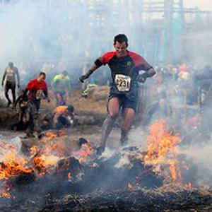 Competitors run through the Killing Fields section of the Tough Guy obstacle course