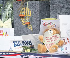 Tributes and get well messages outside Bolton's Reebok Stadium yesterday