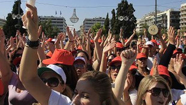 A nurse shouts slogans during a protest by hospital staff in Athens (AP photo)