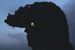 A Canadian soldier uses his night vision goggles during a patrol in the Panjwai district of Kandahar province in southern Afghanistan yesterday