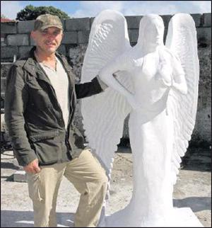 Michael Neter with the 'angel' for auction in aid of the St. Vincent de Paul.