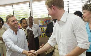 Prince Harry meets Gary Barlow during his visit to a youth community centre in Kingston, Jamaica as part of his Diamond Jubilee tour where he is a representing Queen Elizabeth II