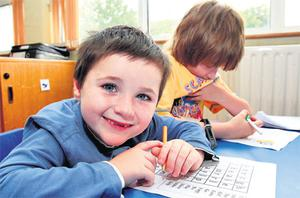 Pupils Michael Rogers (6) and Jason Gallagher (8) at the Achieve ABA school in Donaghmede, Dublin yesterday afternoon. Their school closes today