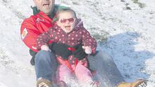 Graham and Sadbh Dunne (3) fromBlanchardstown enjoy the icy conditions at the Phoenix Park, Dublin, yesterday