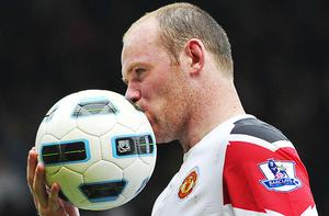 Wayne Rooney leaves the field with the match ball after his hat-trick during Manchester United's 4-2 victory over West Ham at Upton Park. Photo: Reuters