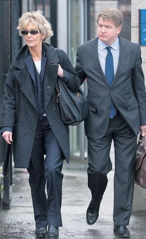 FEELING HOUNDED: Brian and Mary Patricia O'Donnell, pictured leaving the Commercial Court, are being sued by Bank of Ireland