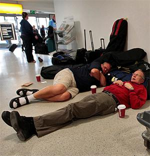 Passengers sleep at Edinburgh Airport as ash from an Icelandic volcano forced the cancellation of dozens of flights to and from Scotland. Photo: Reuters