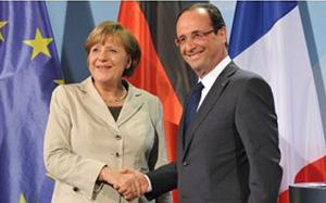German Chancellor Angela Merkel and French President Francois Hollande shake after their talks in the Chancellery in Berlin