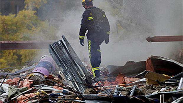 A rescue worker looks for signs of life in the rubble of the CTV building in central Christchurch. Photo: Reuters