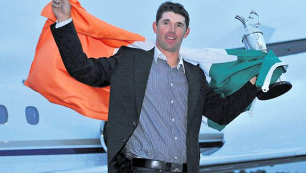 Padraig Harrington steps off a jet with the Claret Jug in 2008