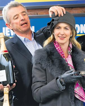 Michael O'Leary took a fancy to his wife Anita's hat during the trophy presentation and tried it on for himself