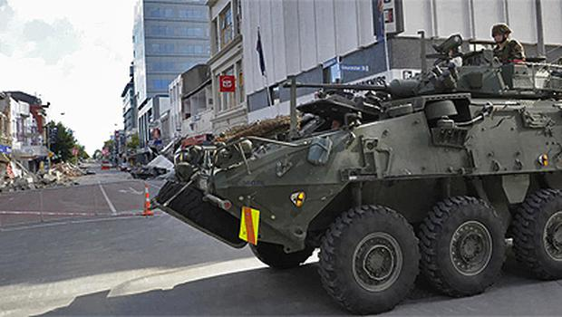 A military vehicle patrols the streets of the central business district in Christchurch, New Zealand. Photo: AP