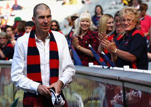 Jim Stynes gets applauded by Melbourne fans before at the Melbourne Cricket Ground