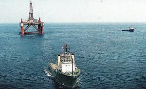 A drilling rig being towed by tug into the Celtic Sea, an area off the south coast which has produced commercial findsof hydrocarbons in the past