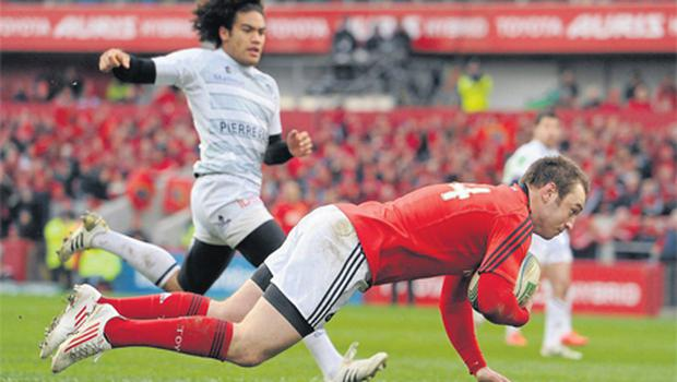 Johne Murphy crosses for his side's first try in the 26-10 win over Castres at Thomond Park which put Munster into the Heineken Cup quarter-finals with a round of games left