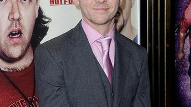 Simon Pegg says he's having a hoot working with Tom Cruise