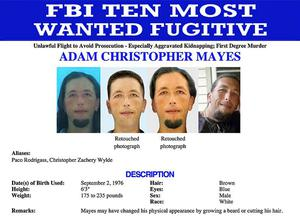 An FBI poster shows suspect Adam Mayes featured on the FBI's 'Ten Most Wanted' list