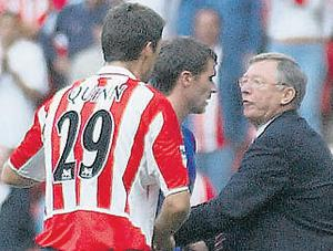 Alex Ferguson steps in after Keane refused to shake Niall Quinn's hand after being sent off during a Manchester United v Sunderland Premiership match