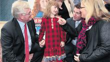 Six-year-old Ella Hendron-Kilcommons, from Dublin, with Tanaiste Eamon Gilmore and Labour TDs Aodhan O Riordain and Ciara Conway at the launch of the party's ad for the children's referendum, in which Ella stars.