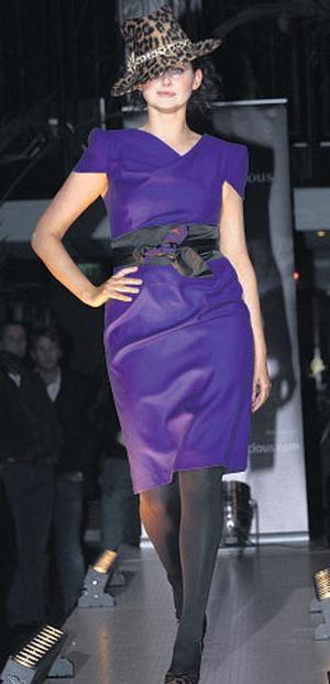 Corina Grant wears a purple dress and leopard-print hat from The Design Centre