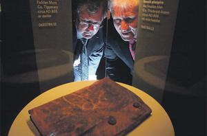 Jimmy Deenihan (right) and Dr Patrick Wallace, director of the National Museum, view the Psalter yesterday