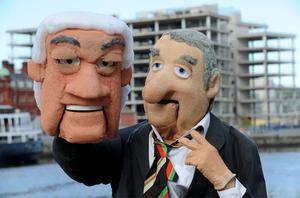 Anglo the Musical pictured the Sean Fitzpatrick and Bertie Ahern puppet in front of the what was to be Anglo Irish Bank HQ