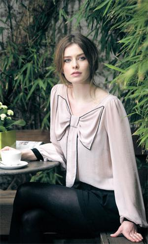 Limited Edition bow blouse in mushroom, €17, and black silky shorts, €17 (due in shops in May)
